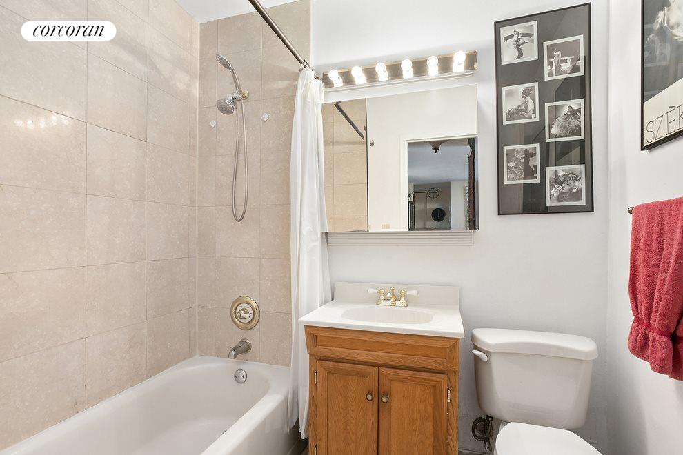 Renovated Bath with Travertine Tiling