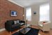 Details; ceiling fan, wood floors, exposed brick
