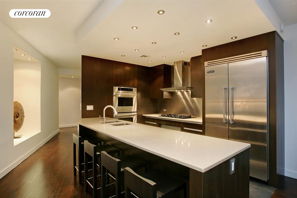 Open chef's kitchen with seating and ample storage