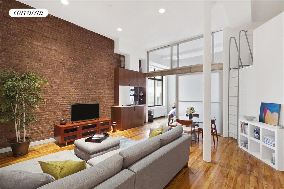 Impressive LR, 13' ceilings, exposed brick wall