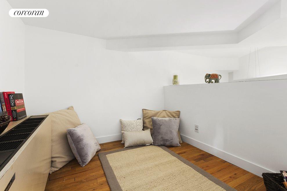 Lounge/possibly office in loft area