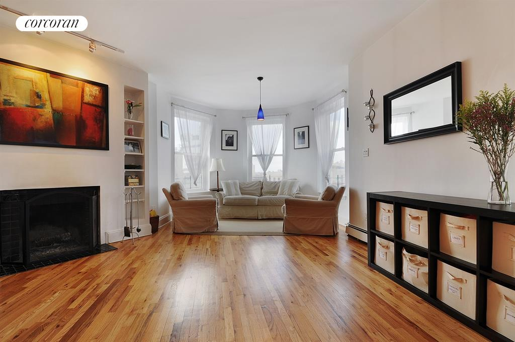 90 Saint Marks Avenue, 2, West-facing living area with WBFP & skyline views