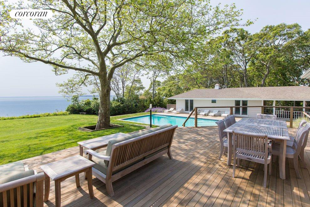Deck overlooking Pool And Water Front