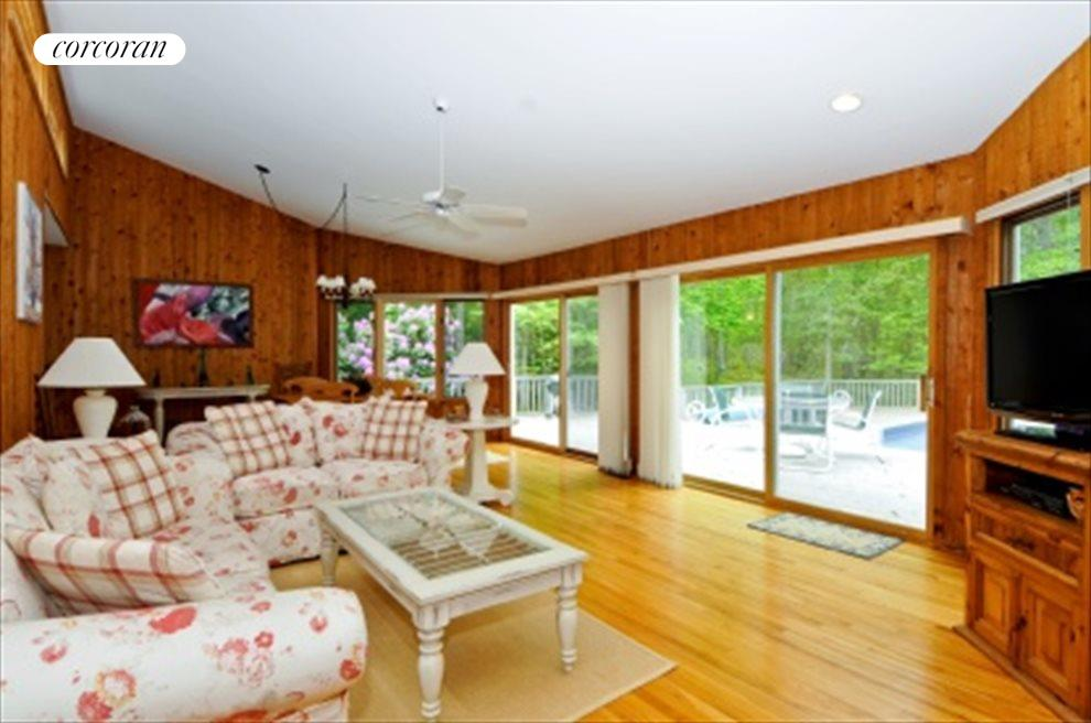 living room opening to deck and pool