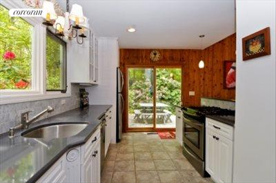 The Hamptons Real Estate | View 29 North Hollow Drive | kitchen opening onto deck