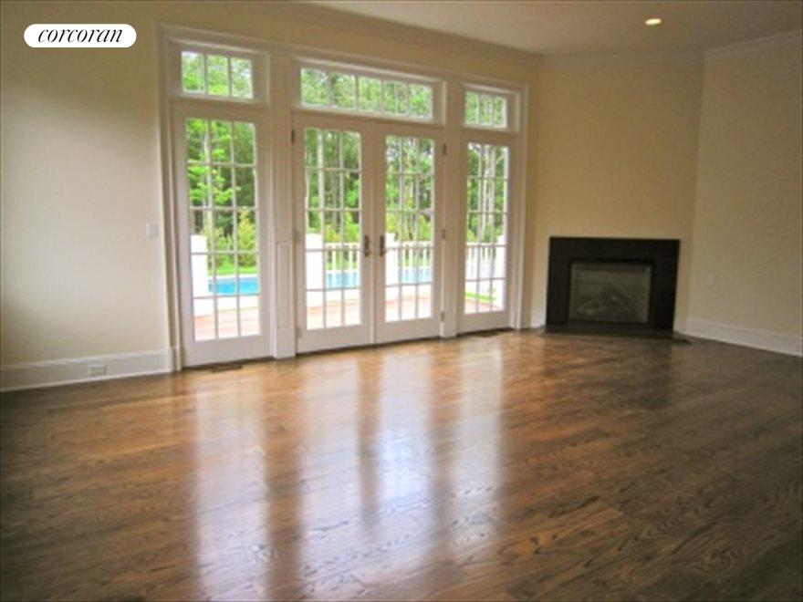 Downstairs Master with fireplace and french doors leading out