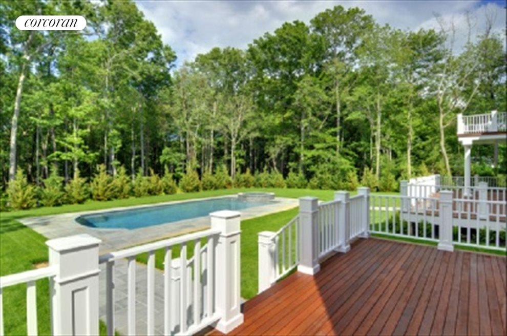 Downstairs master bedroom has deck overlooking pretty back yard