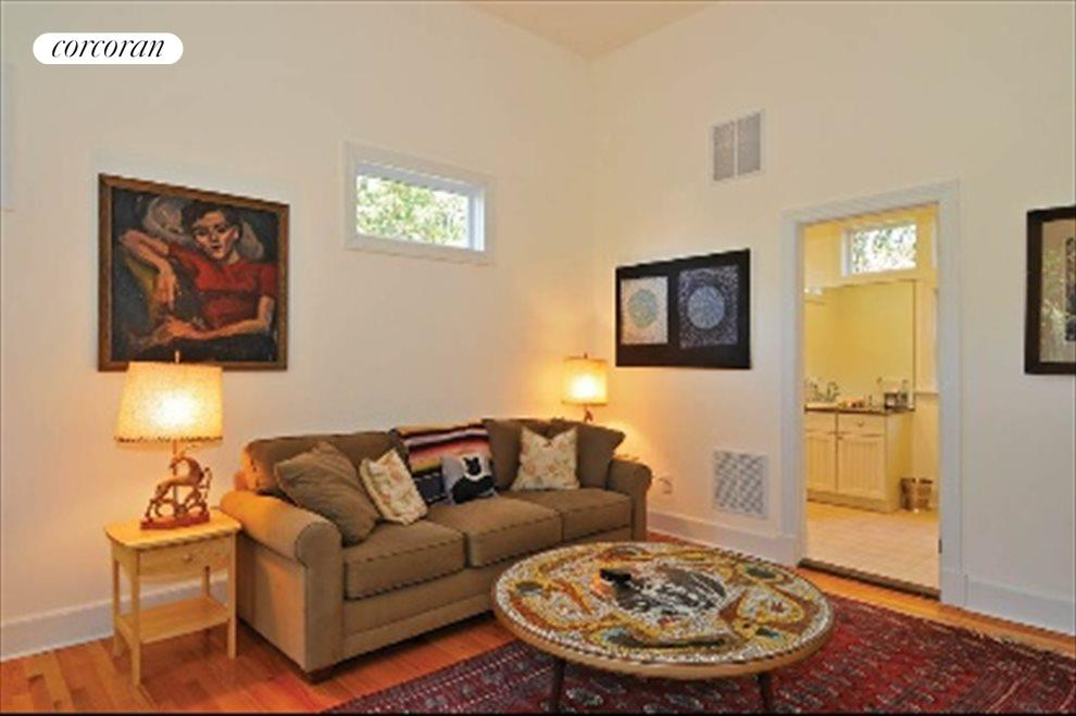 Den with fireplace also has full bath