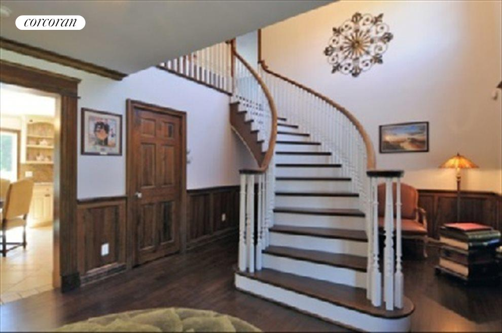 Entry with suspended curved staircase