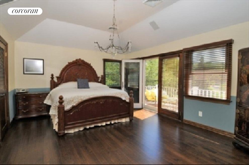 Master bedroom with French doors to waterside deck