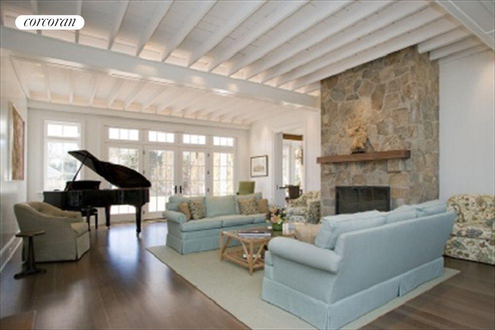 Great Room Boasts Fieldstone Fireplace