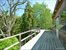 Second story 2 bedroom guest suite feature large treetop deck