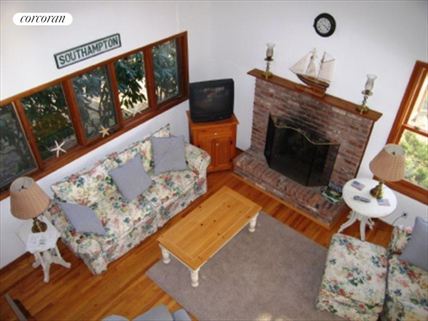 Living Room with Wood Burning Brick Fireplace