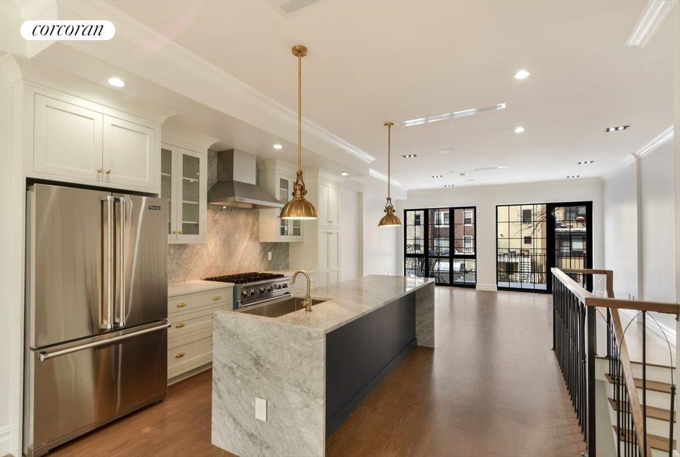 Open Kitchen Featuring 10' Waterfall Island