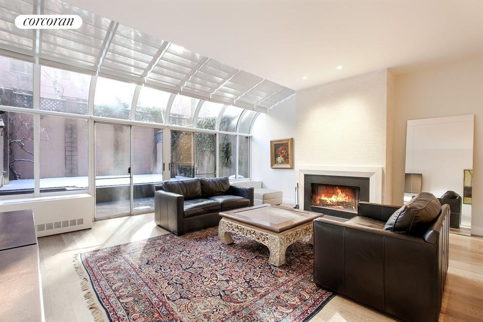 Sunny Living Room with Solarium Wall