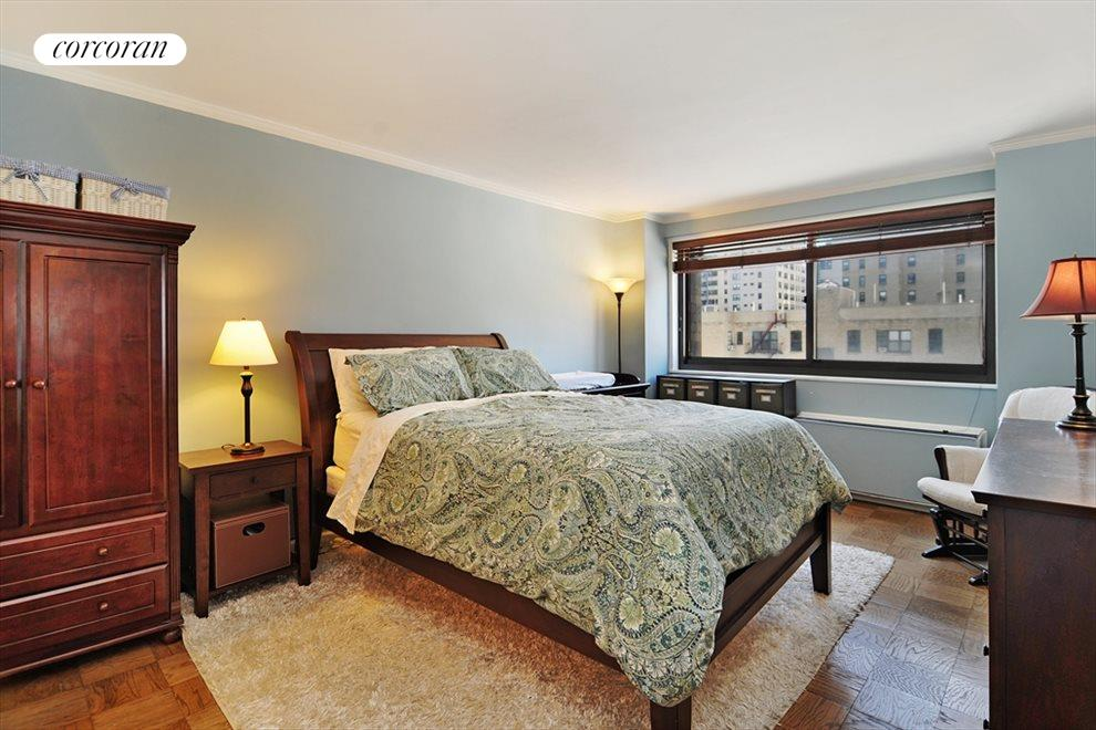 Large master bedroom with sunny view
