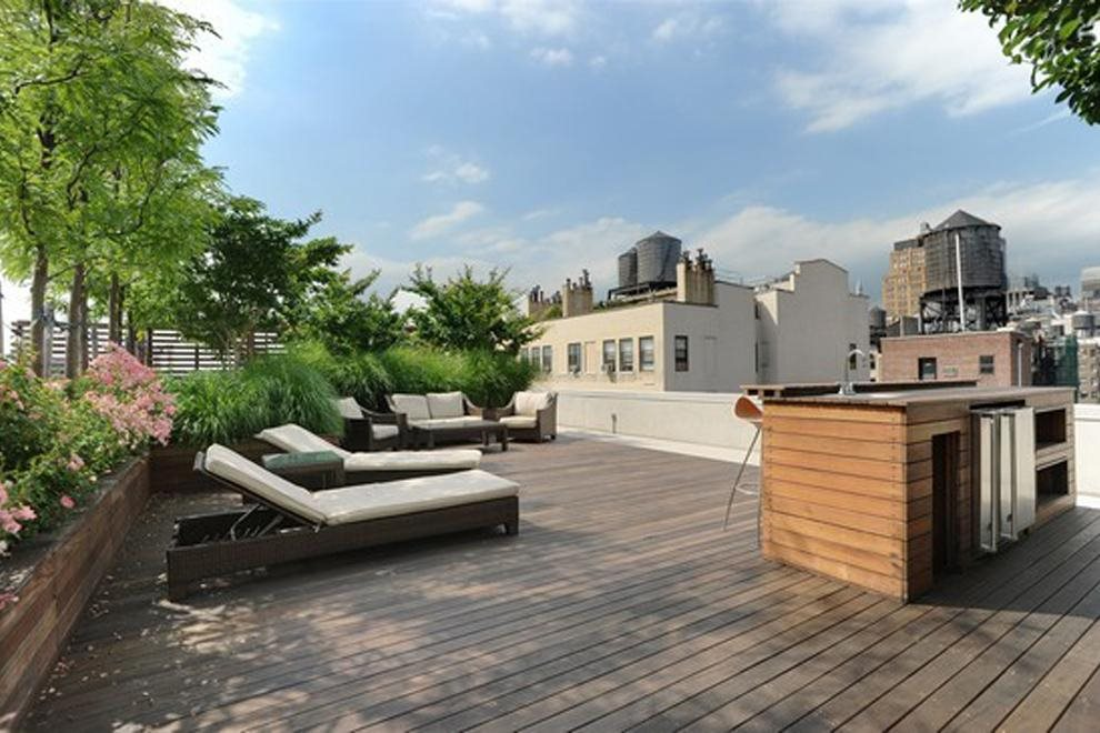 Furnished roof deck with cabanas, shower and grill