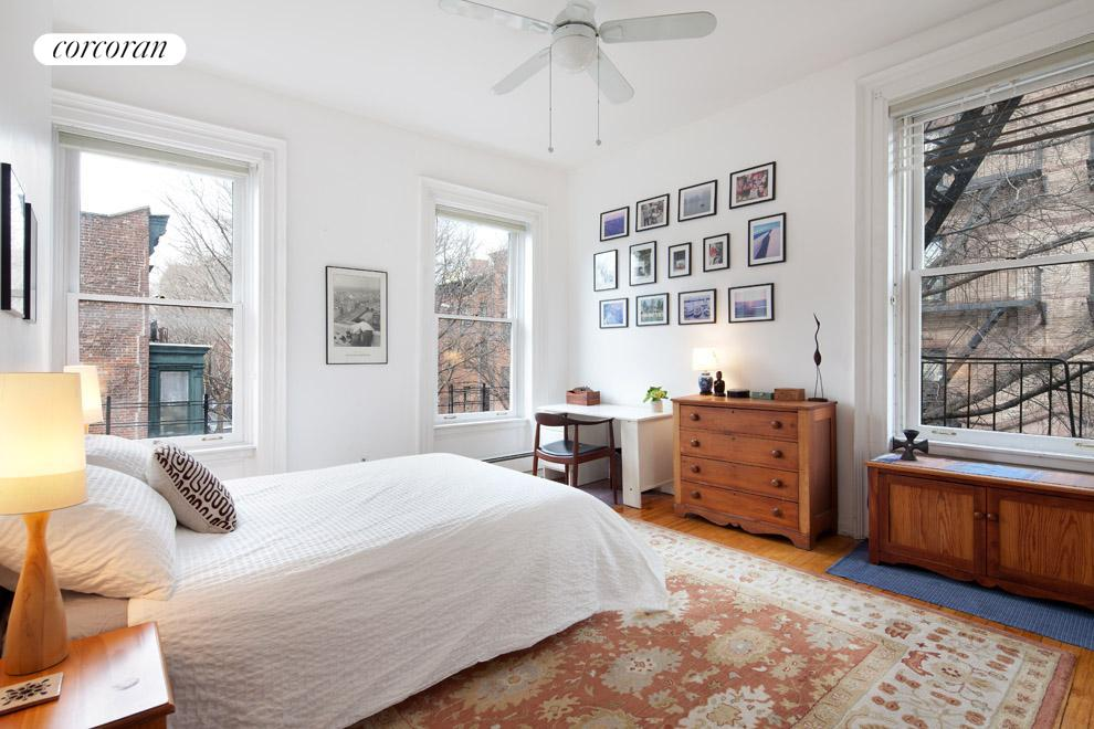 Corner bedroom overlooking tree-lined Pacific St.
