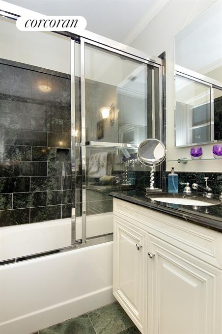 Large guest bath with glass enclosed shower & tub