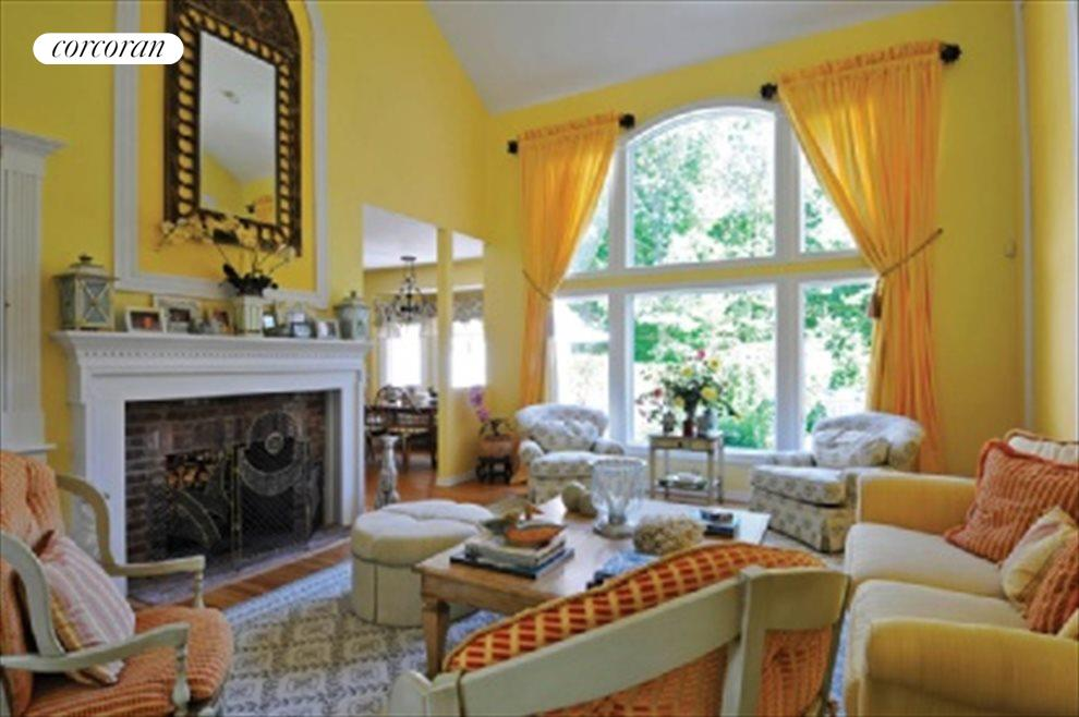 Dramatic, double height great room with fireplace