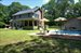 30 Winterberry Lane, Pool, covered entertaining porch and 2-car garage complete the picture