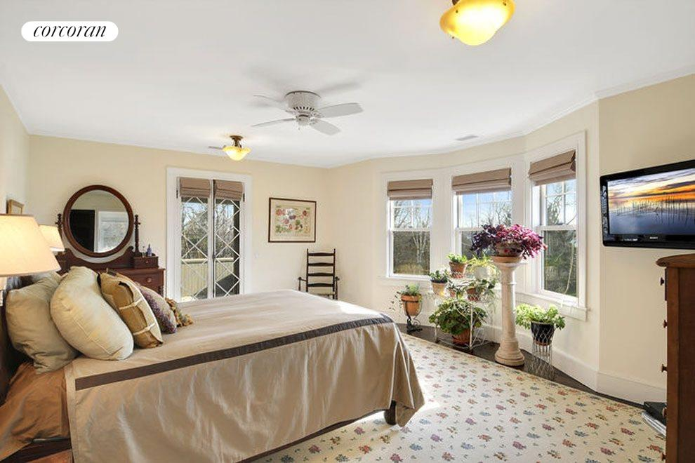 Master suite with water views of Sag Harbor Bay