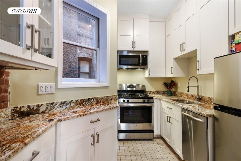 All new windowed kitchen with stainless appliances