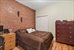 333 East 92nd Street, 4B, Second bedroom with exposed brick