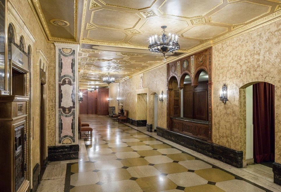Wide corridor with marble mosaic panels