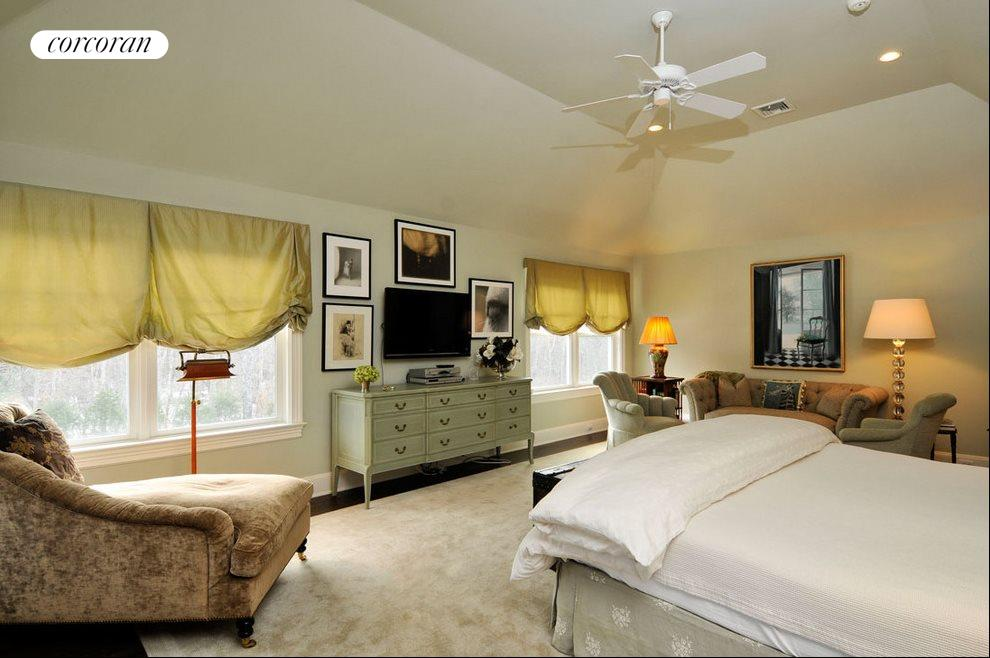 Master suite accommodates two seating areas