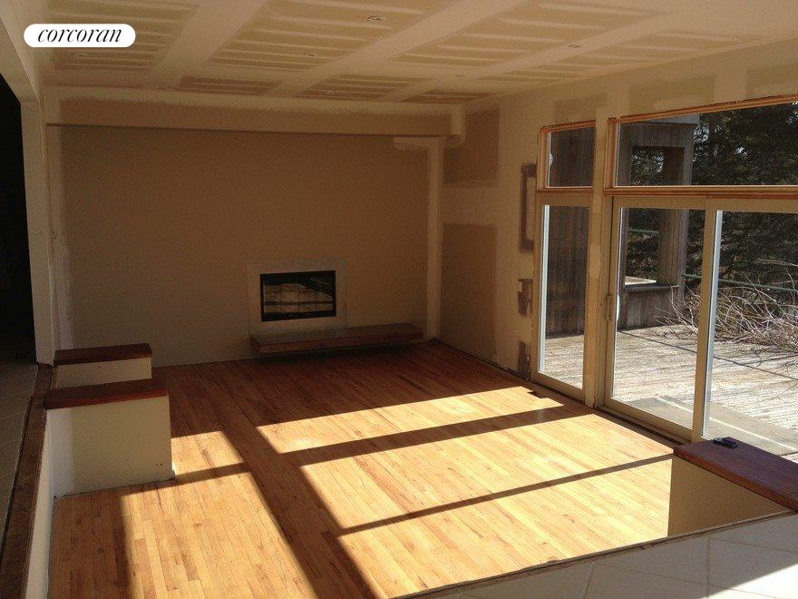 Great room w/Fireplace, doors lead to deck/water