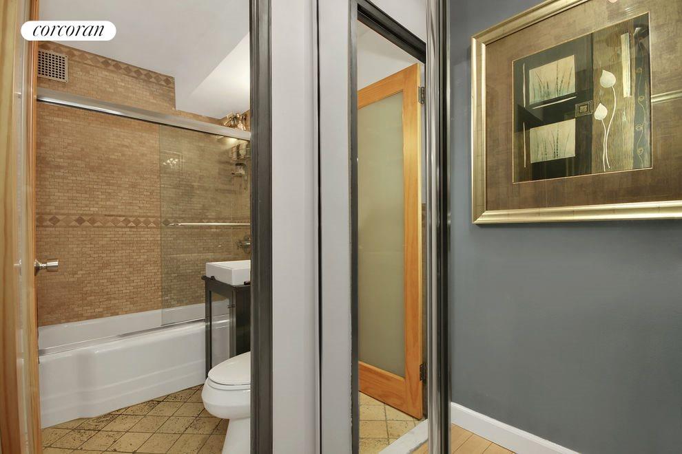 Tumbled marble tile bathroom