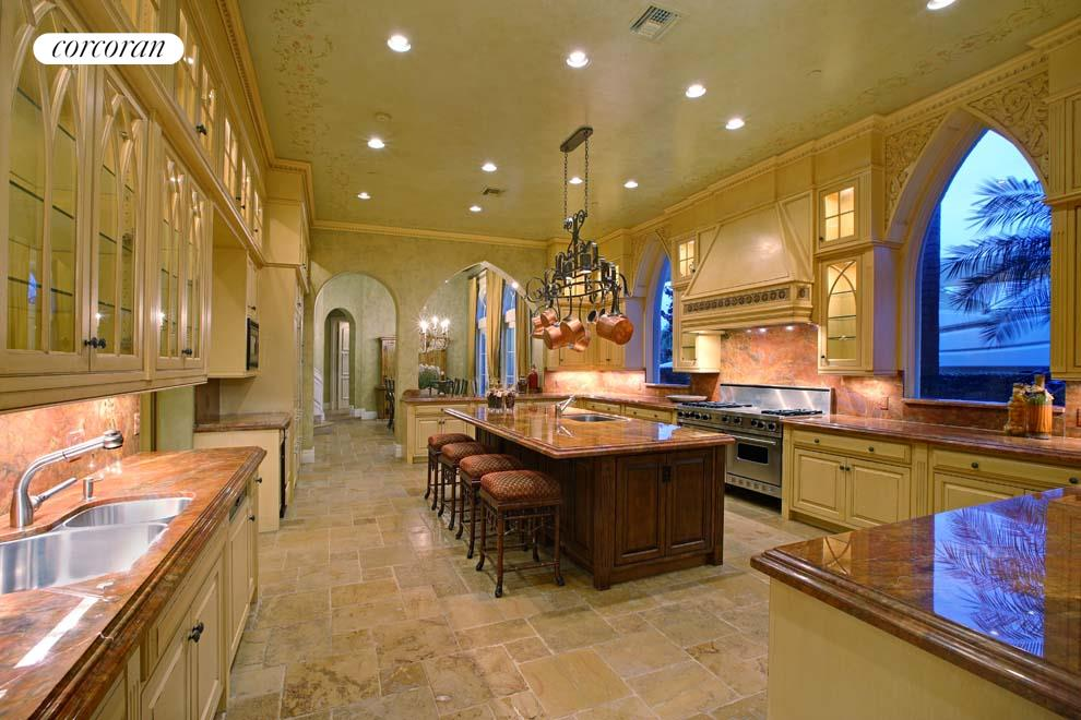 Open kitchen featuring custom cabinetry