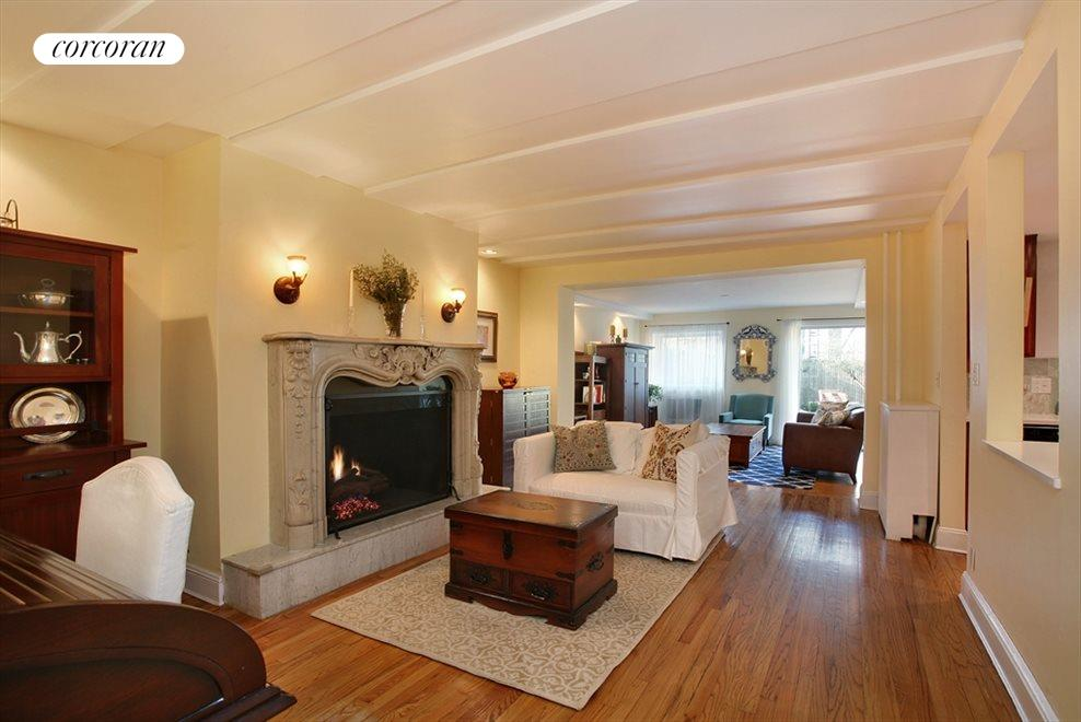 Living room with marble mantle and gas fireplace