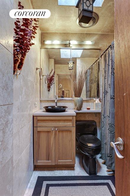 Renovated Bathroom with Skylight