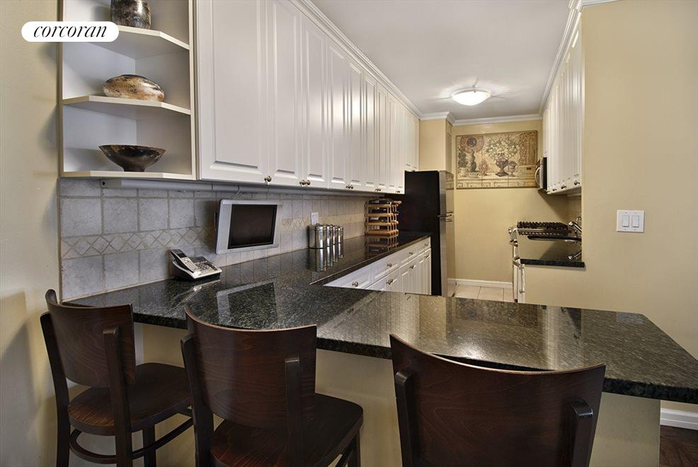 New York City Real Estate | View 178 East 80th Street, #3ABC | Renovated Open Kitchen with Breakfast Bar
