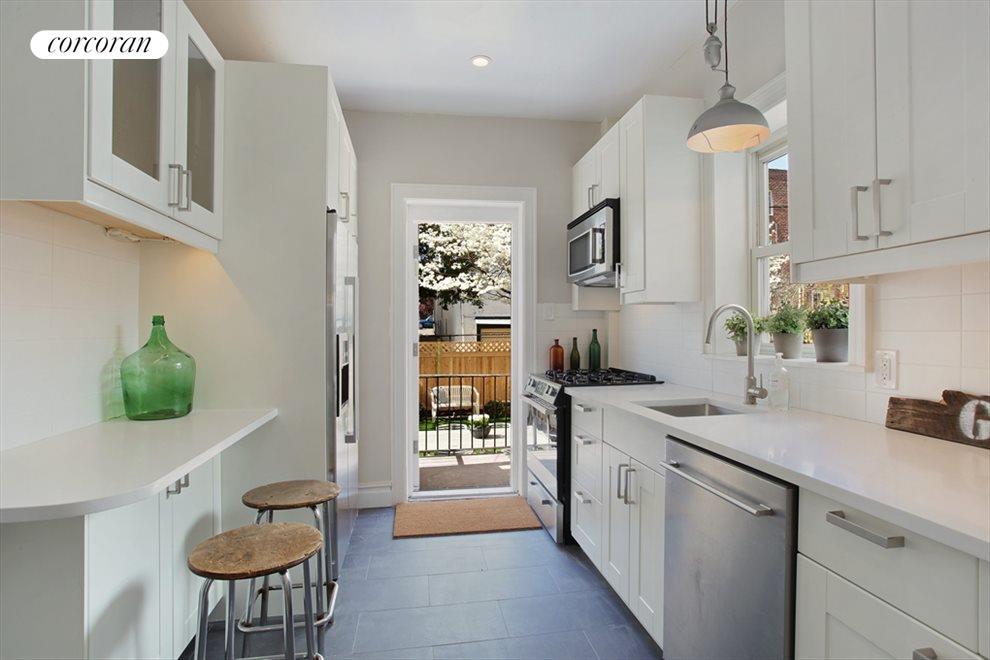Brand new windowed kitchen leads to garden