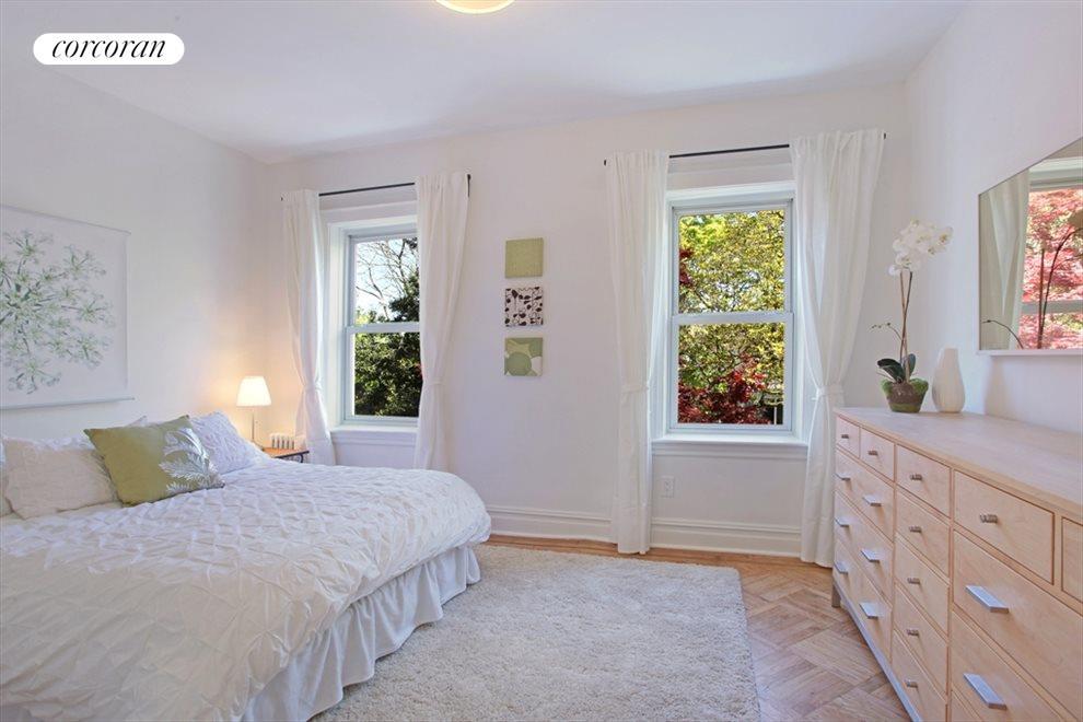 Master bedroom overlooks Japanese maple