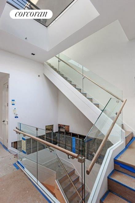 Dramatic Staircase and Skylights
