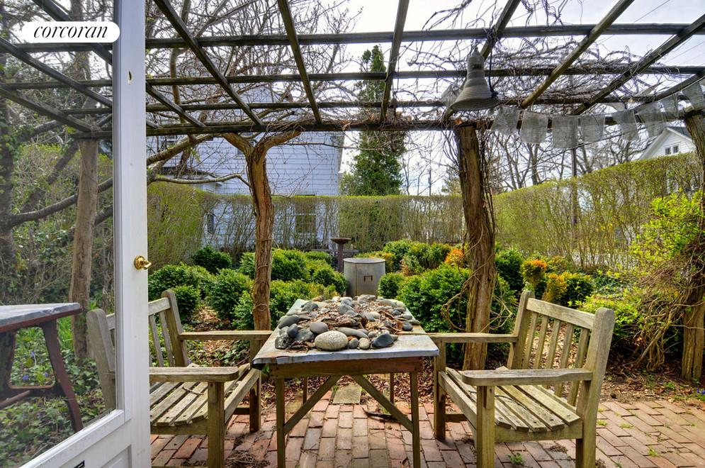 Pergola-covered outdoor dining