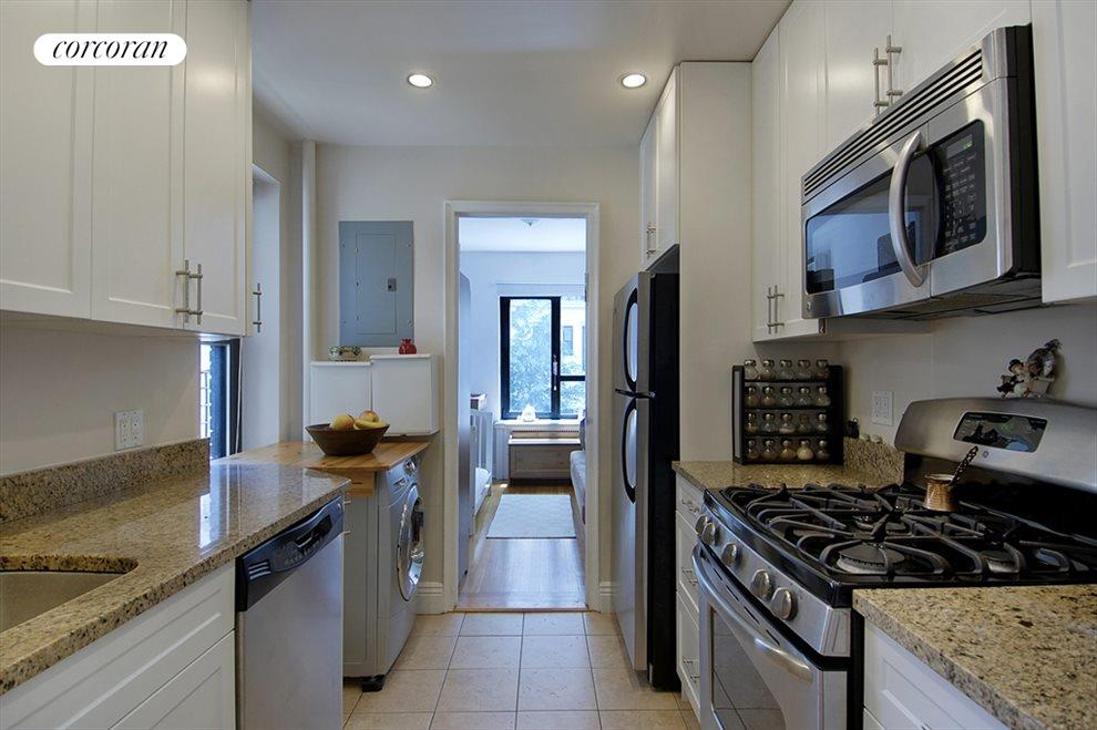 windowed kitchen with washer hook-up