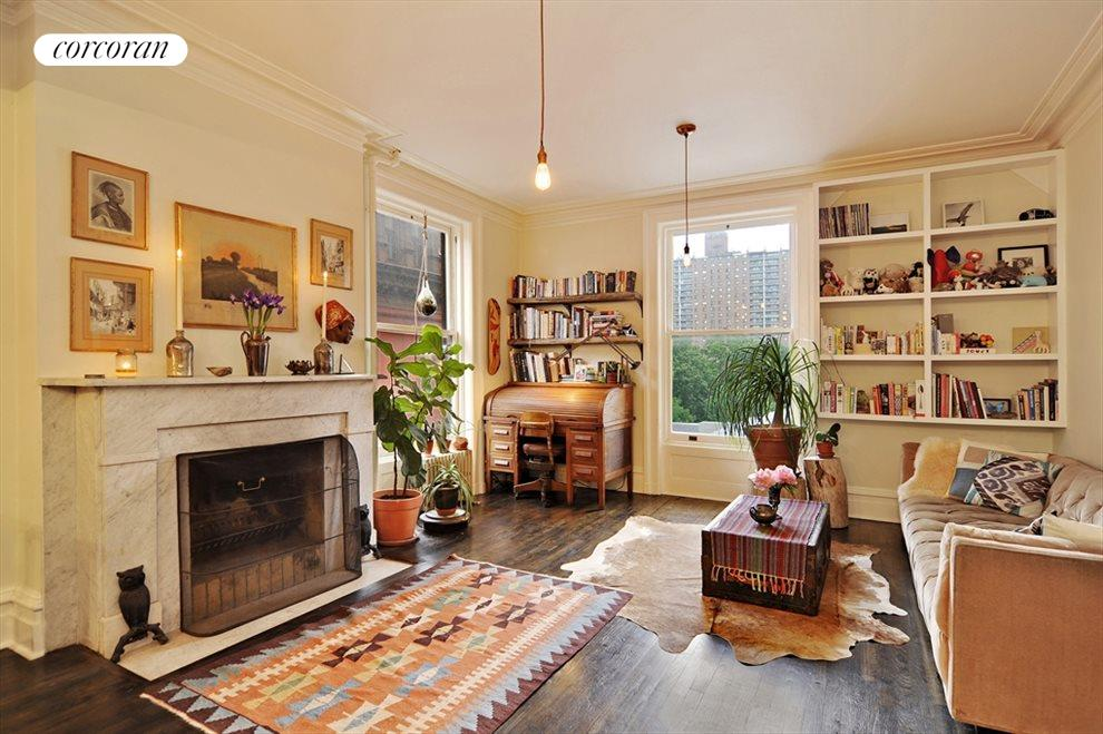 Large and open with a wood burning fireplace.