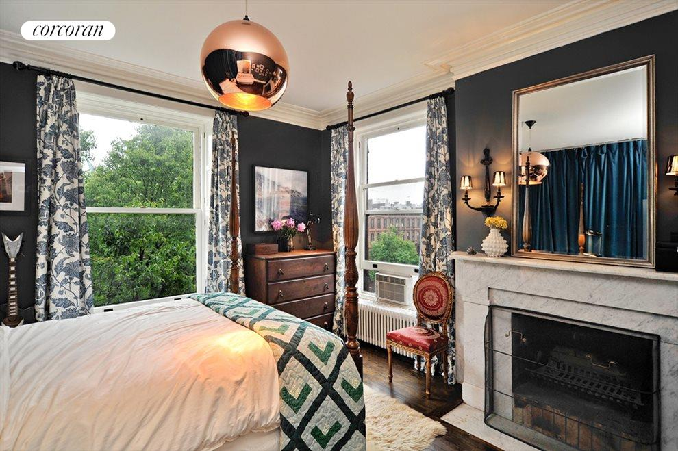 Two large windows & a wood burnign fireplace!