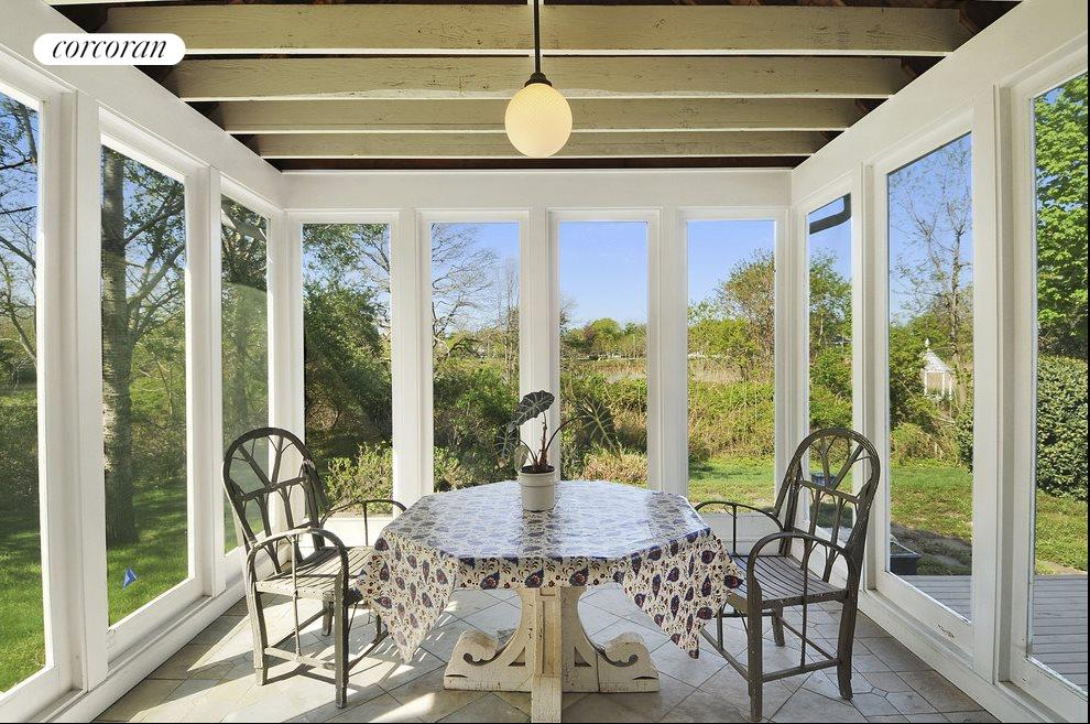 Screened porch with pond views