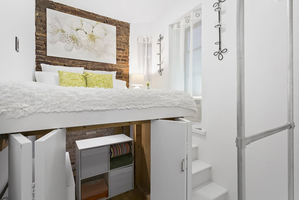 Cozy Bedroom with Storage Loft