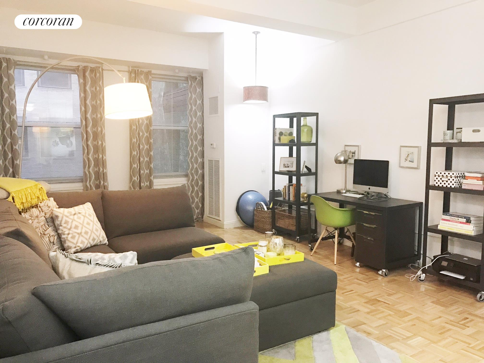 88 Greenwich Street, 526, Living room with Bed, next to windows