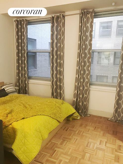 Living room with Bed, next to windows