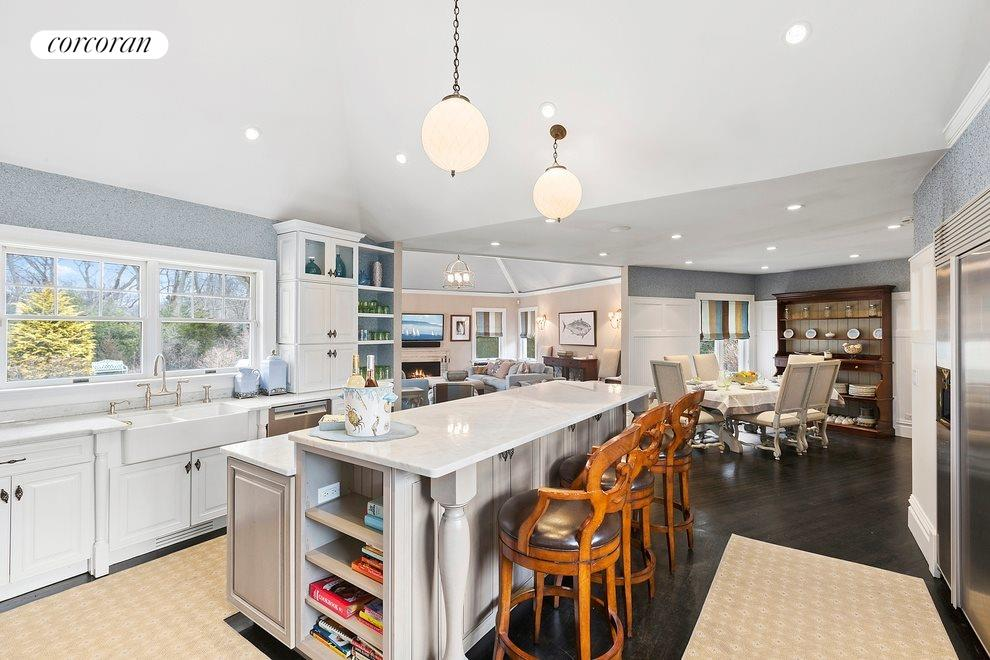 Open kitchen with breakfast room beyond