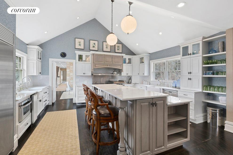 Kitchen with professional appliances including a Garland double range