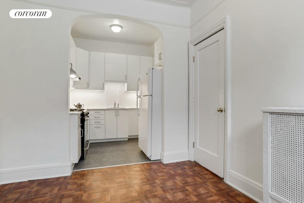 Renovated kitchen flows into the dining area